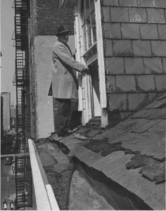 Joseph Roberto inspects the roof of the Old Merchant's House